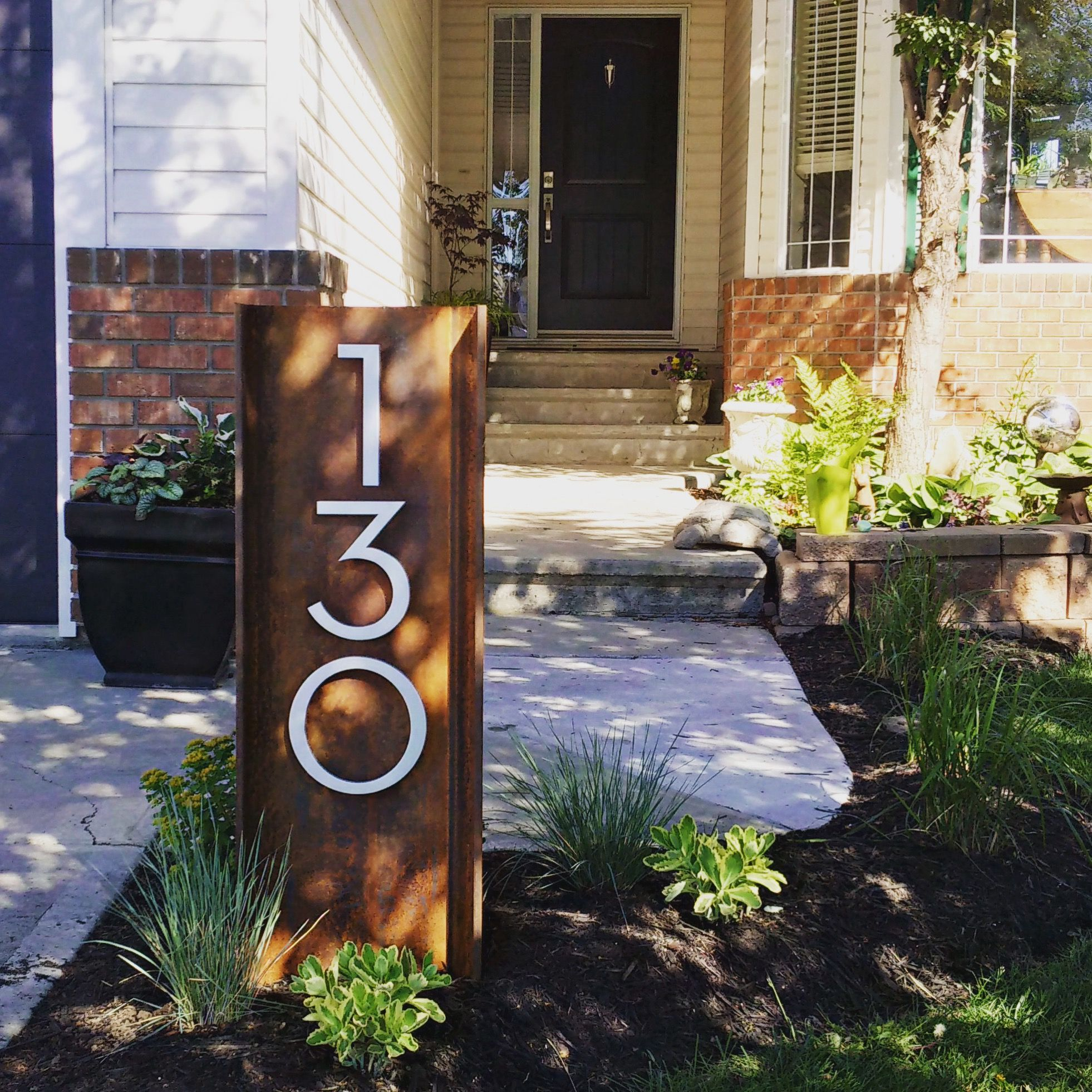 Curb Appeal On The Rise We Love These Palm Springs Numbers Installed Vertically On This Exposed Stee House Number Ideas Outdoor House Numbers Diy Curb Appeal
