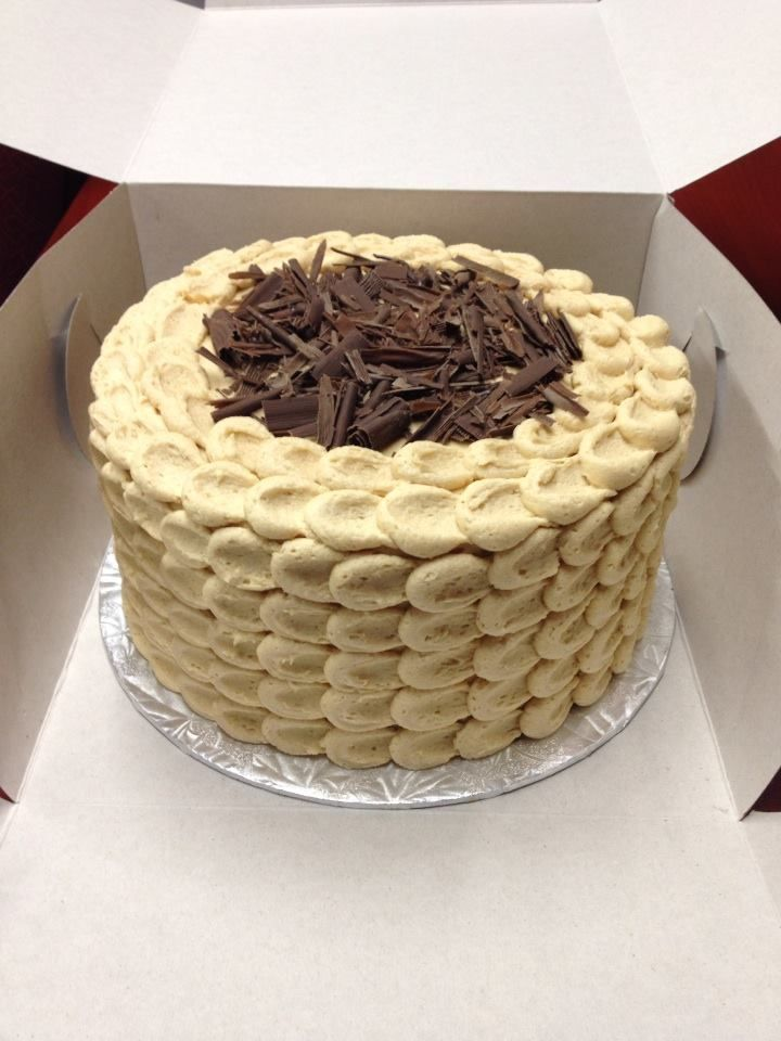 Banana cream cake with a layer of chocolate cake in the