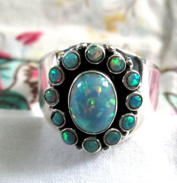 RING  Large FIRE  OPAL  Surround by 12 Small Fire by MOONCHILD111, $27.95 https://www.etsy.com/shop/MOONCHILD111