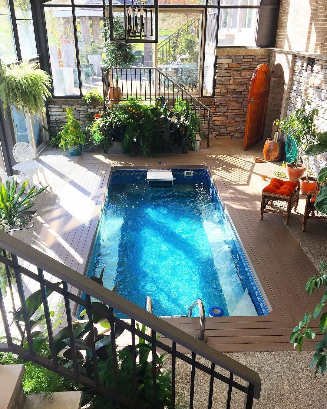 An Original Endless Pools Installed Indoors And In Ground In This Plant Filled Sunroom Indoor Swimming Pool Design Indoor Pool Design Small Indoor Pool