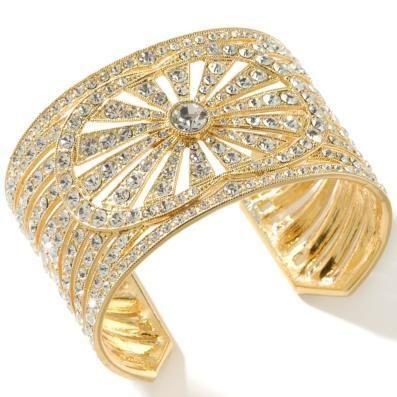 Gold and diamond cuff.