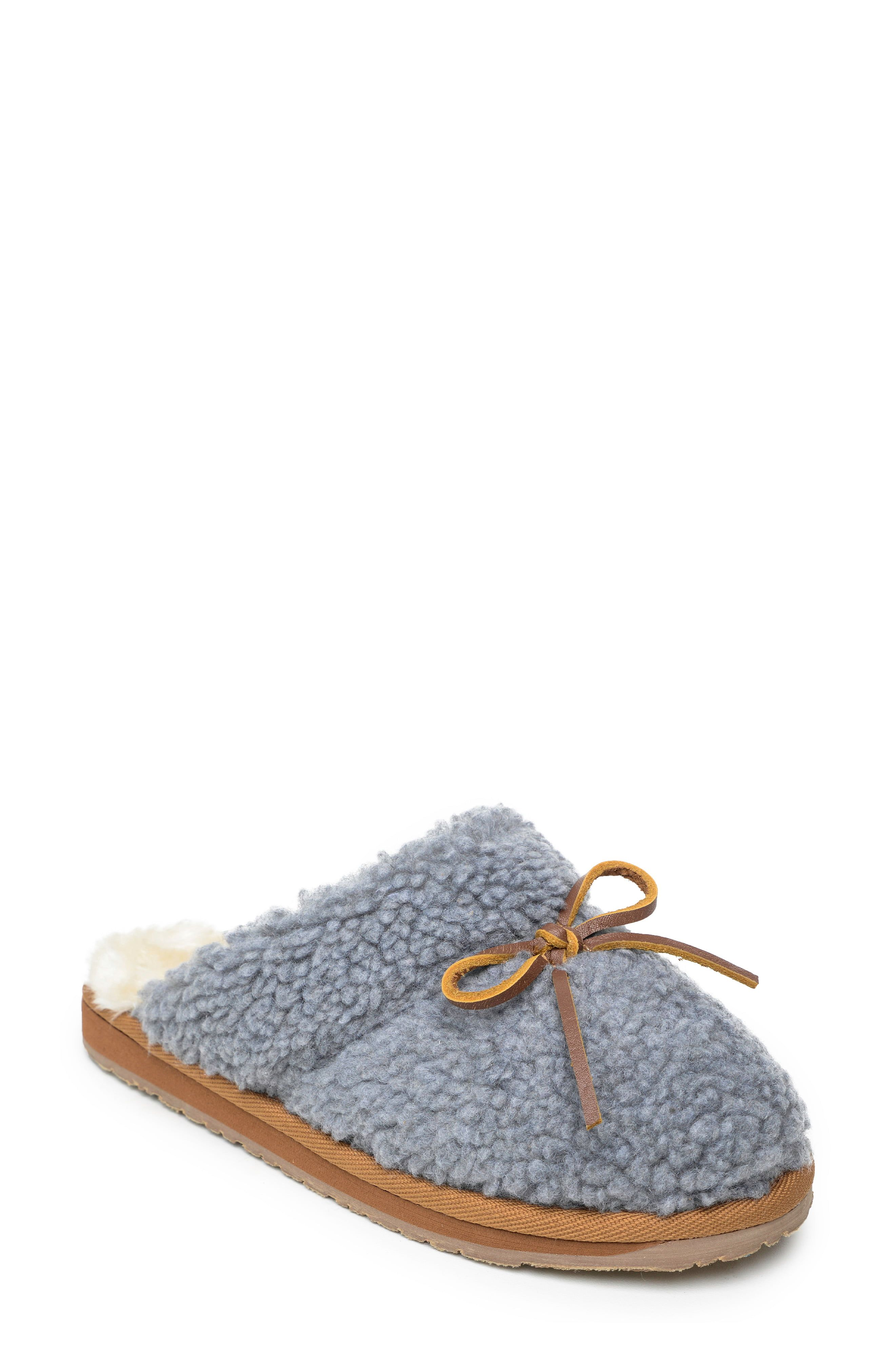 Treat yourself-or at least your feet-with these bow-topped slippers in comfy, cozy faux fur you'll love slipping into after a long day. Style Name:Minnetonka Flurry Scuff Faux Fur Slipper (Women). Style Number: 6044287. Available in stores.
