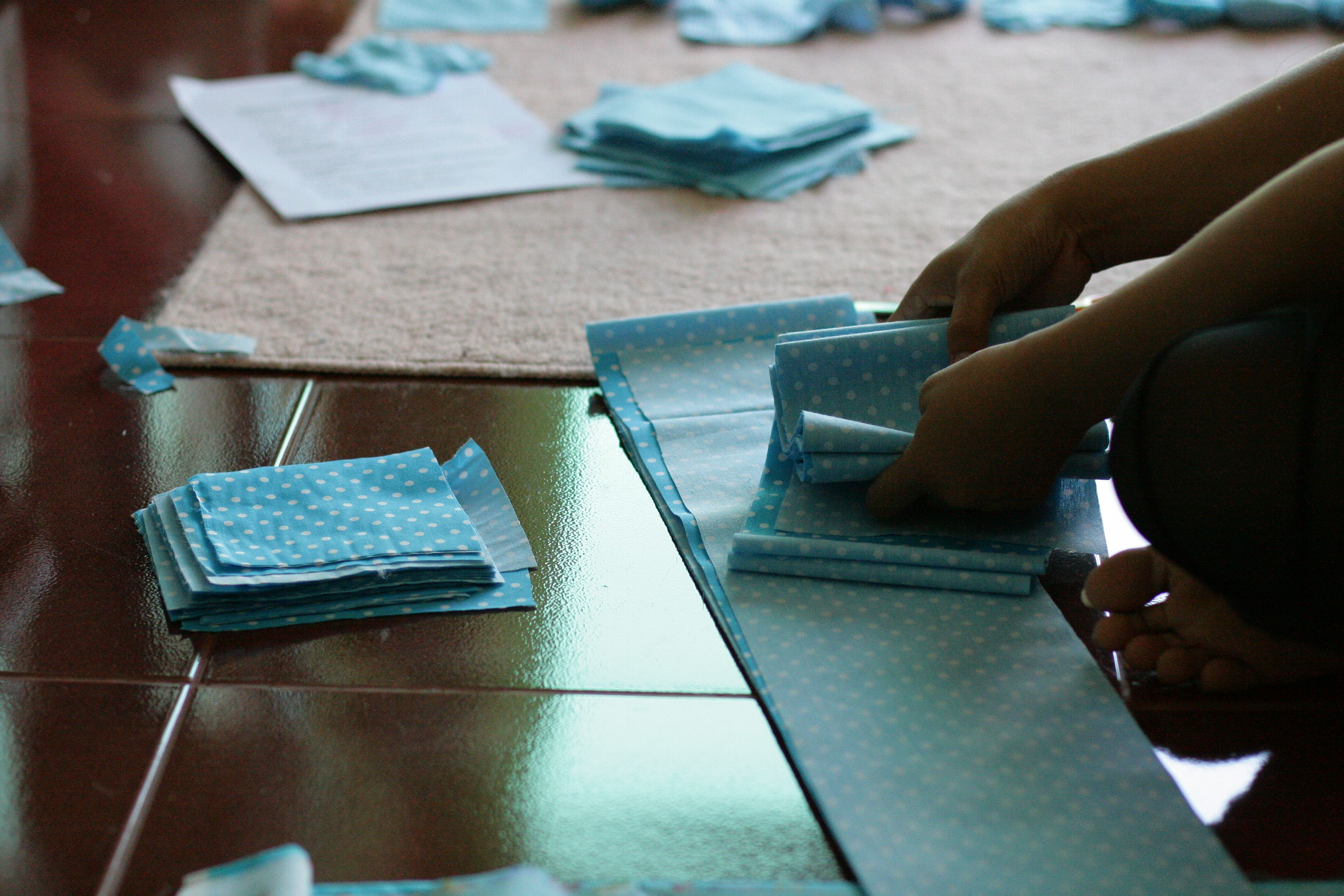 Cutting the fabric for sewing the letters for the personalized garlands #fairtrade #Thailand #handmade