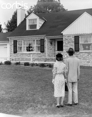 1940s 1950s Couple Standing Outside Looking At Stone ... 1940s White House Scottie
