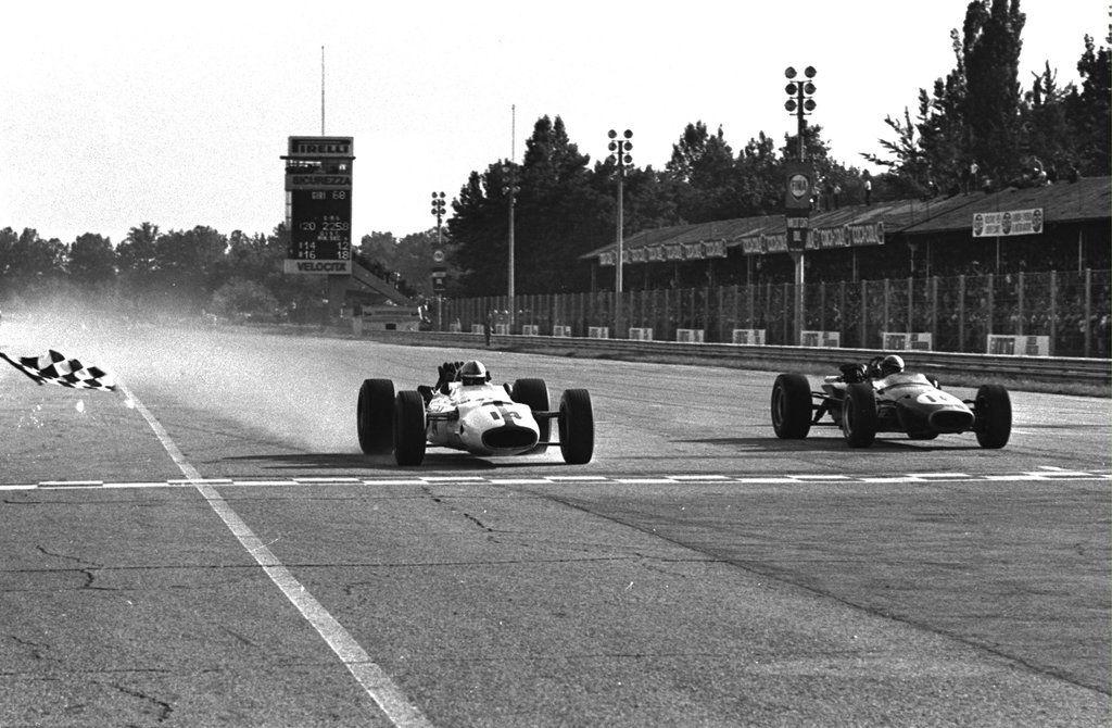"John Surtees (GBR) (Honda Racing), Honda RA300 - Honda RA273E 3.0 V12 (finished 1st) and John Arthur ""Jack"" Brabham (AUS) (Brabham Racing Organisation), Brabham BT24 - Repco 740 3.0 V8 (finished 2nd) (+0.2s),1967 Italian Grand Prix"