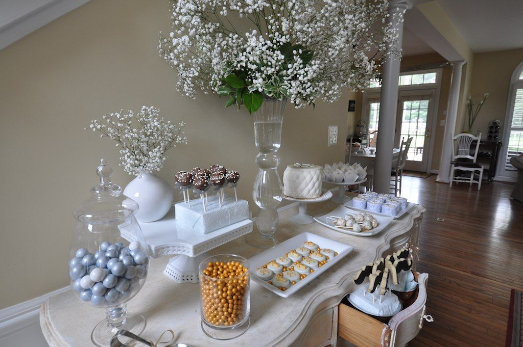 First communion dessert table using a chest of drawers