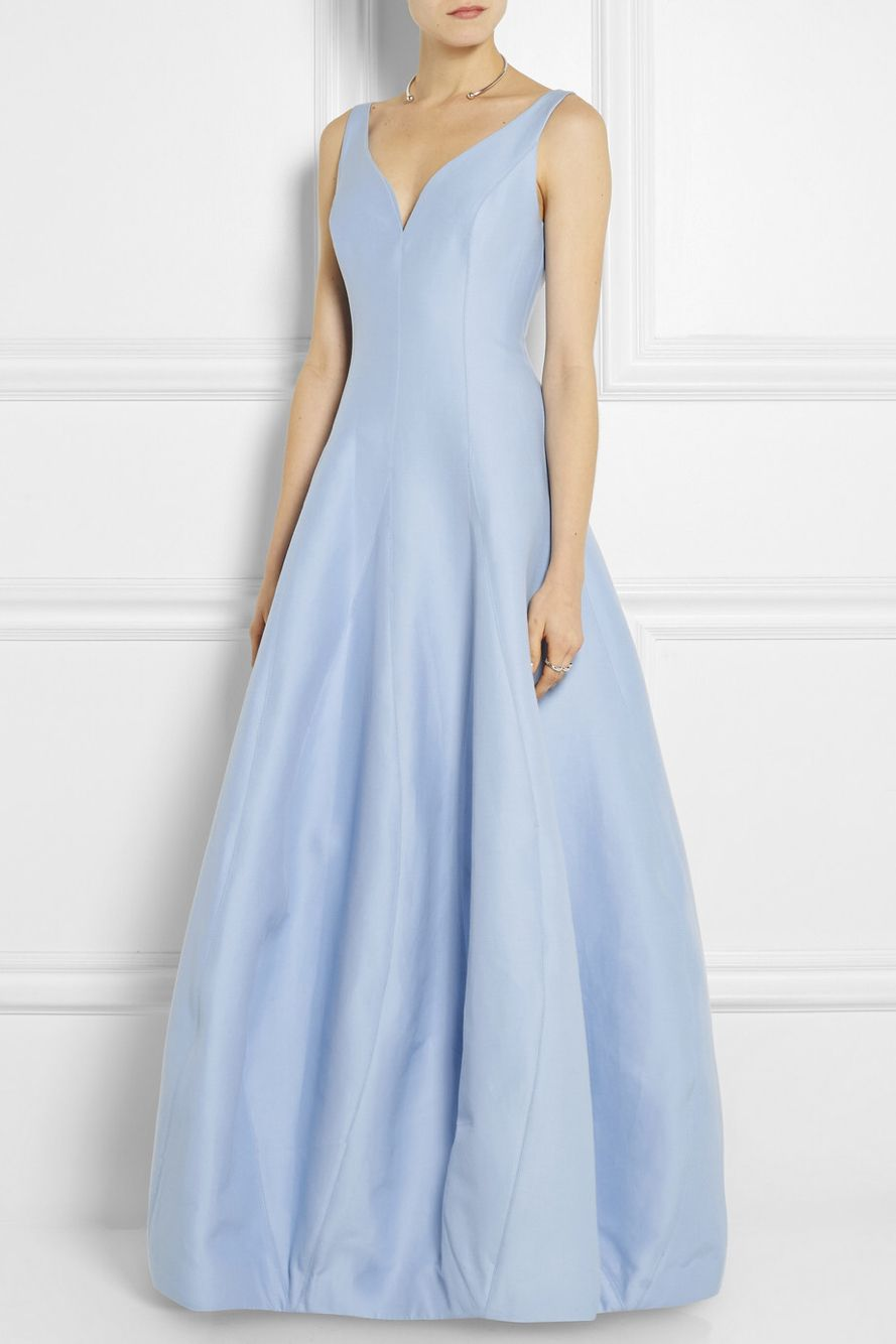 A power blue gown by halston heritage fitted through the bodice