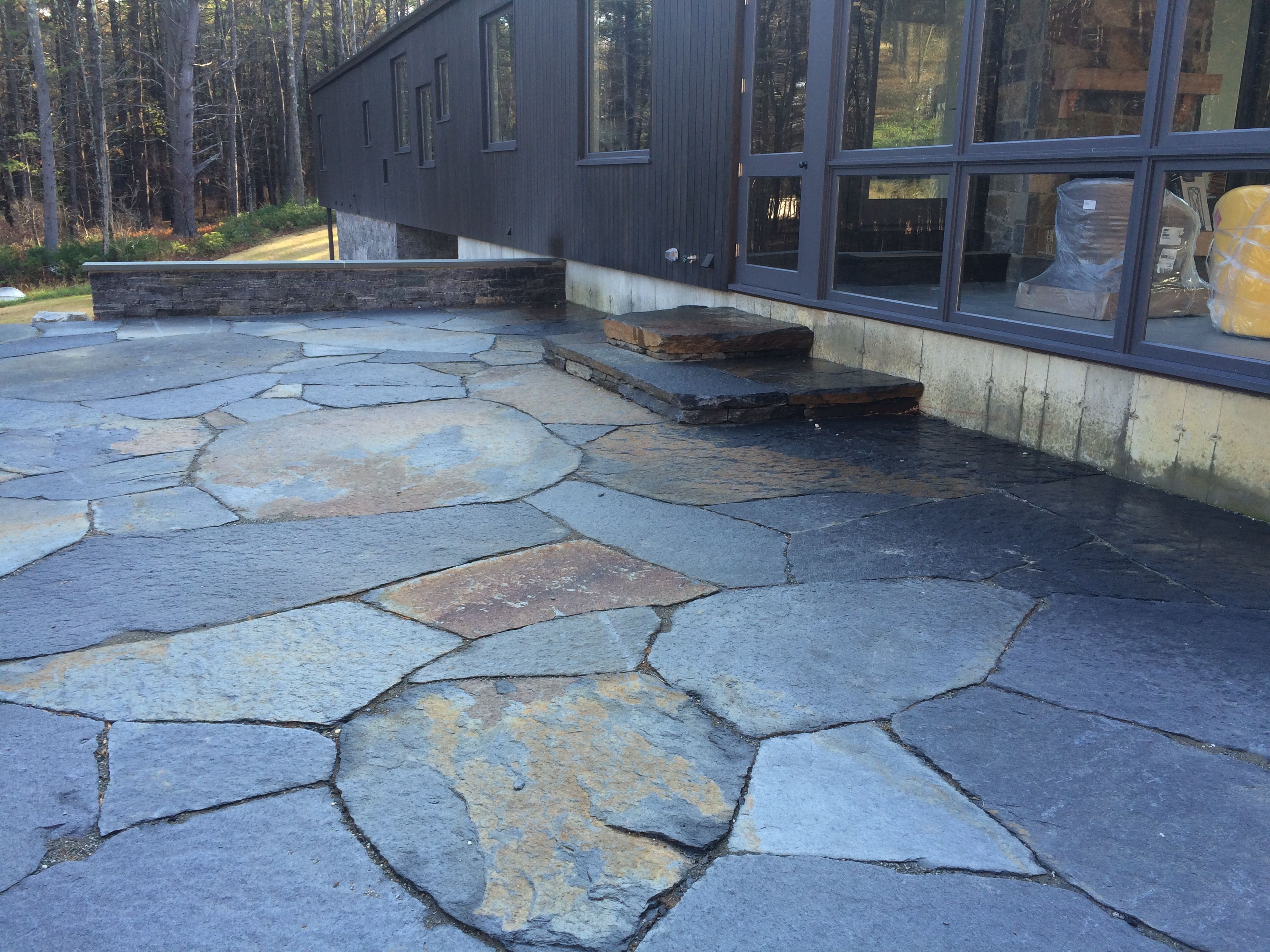 Goshen stone patio and stairs concrete retaining stem wall with
