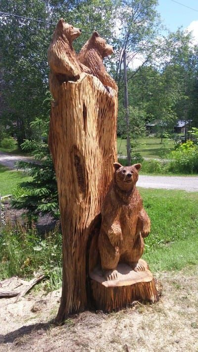 Wood carvings and tree sculptures by jim menken of