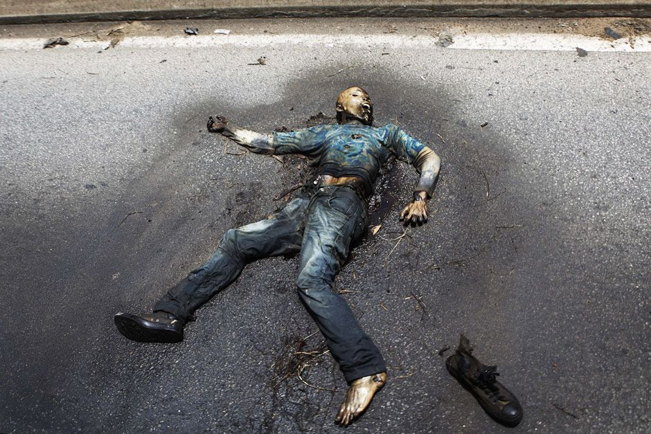 A decomposing body lies on a road in Abidjan April 14 ... Human Decomposition Time Lapse