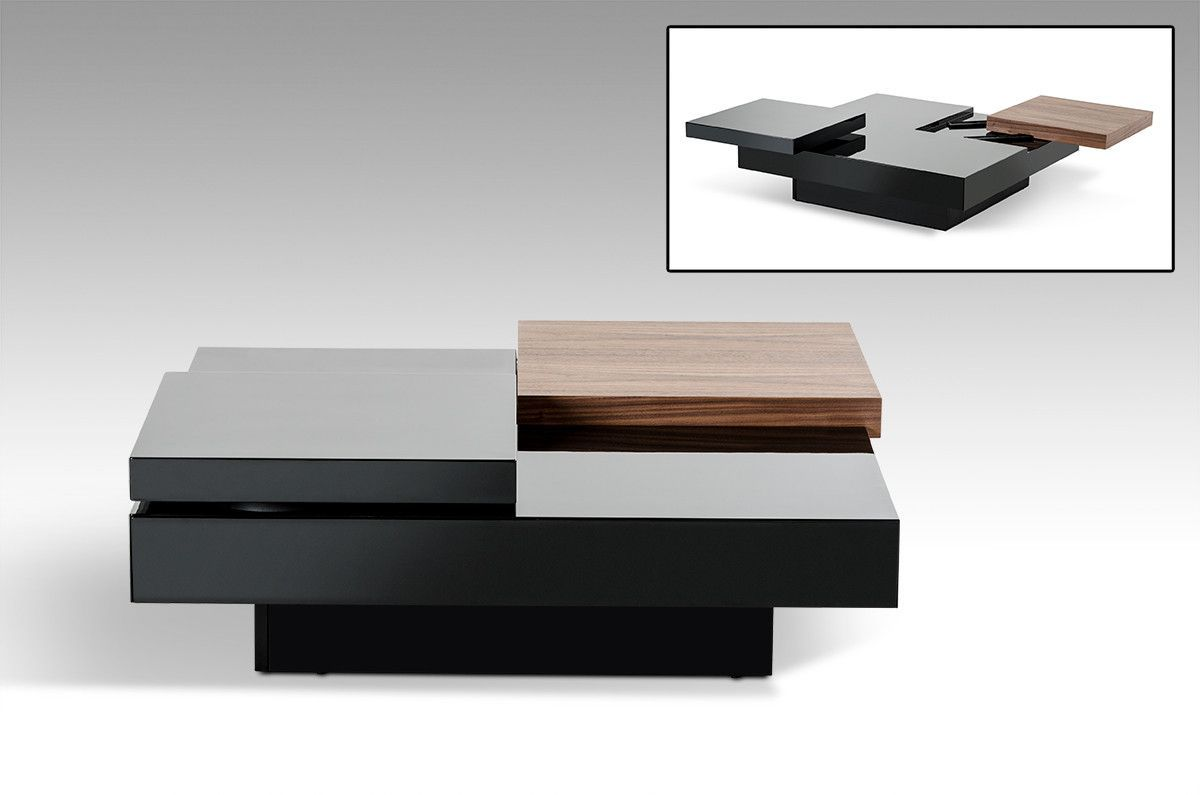 """Modrest Ambry Modern Walnut and Black Coffee Table. The Ambry modern walnut and black coffee table exhibits a geometric movable design featuring an adjustable table top. The mixture of black lacquer and a walnut finish accent produced a charming design. Pushing the walnut finished table top outwards reveal a hidden storage. This modern coffee table is fitted with a soft-closing drawer. Dimensions: W39"""" x D39"""" x H13""""  Height Of Base: 5.5""""  Height of Middle Section: 5""""  Size of Rotating…"""