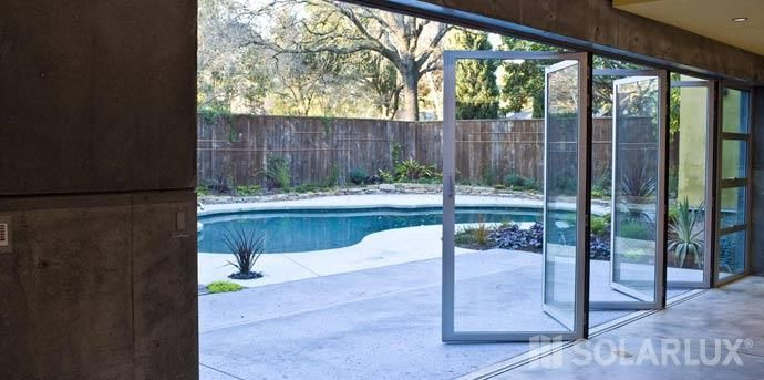 Solarlux puertas plegables de cristal terraza balc n for Puertas para patio exterior