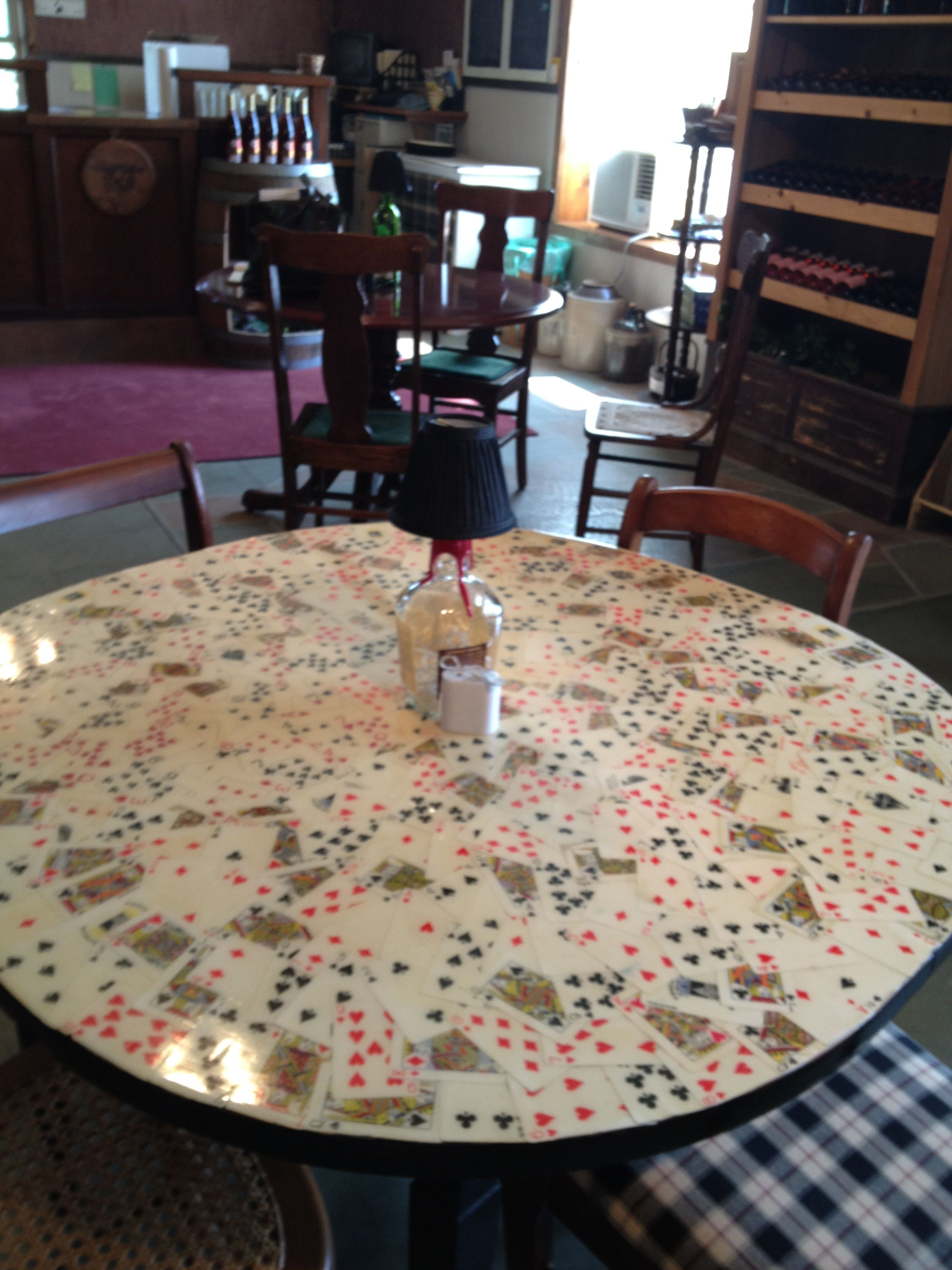 Took Playing Cards Glued Them To A Table And Sealed The Table