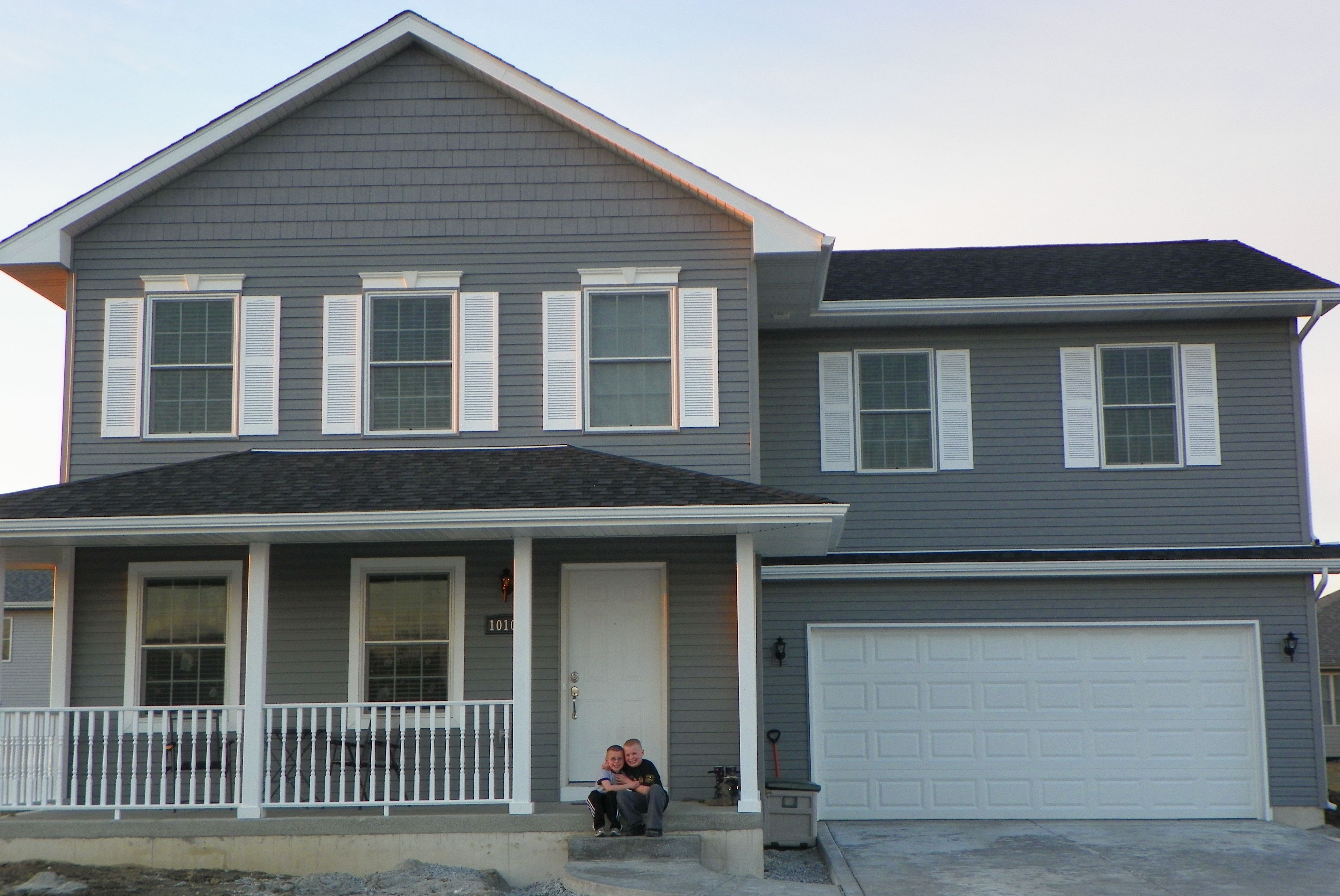 Front View Of My Dark Gray House With White Shutters Will Do Black Door In Spring White Shutters Gray House Exterior House Shutters