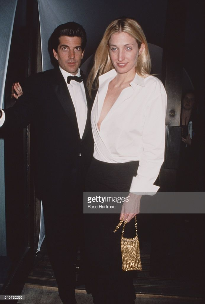 John F. Kennedy Jr. with his wife Carolyn Bessette Kennedy a ...