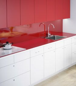 A View Of Kitchen With White Base Cabinet Fronts And Red Wall Cabinets