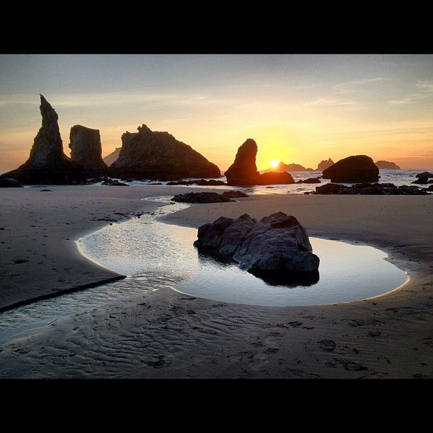 City of Bandon in Oregon Small coastal town with cool rock formation in water on coast at Konenburg County Park