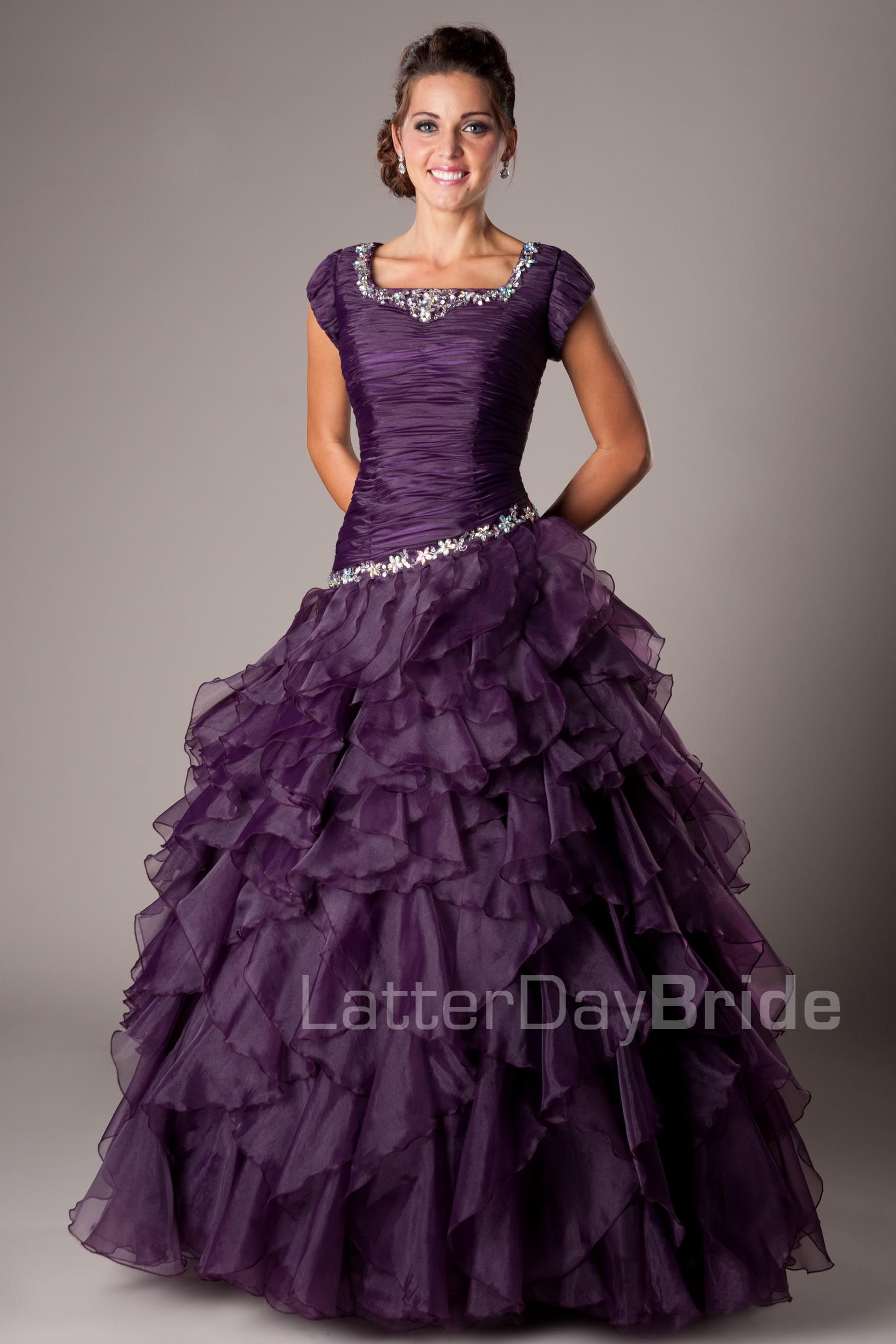 Maci- for the woman/young lady looking for a more modest gown. But ...