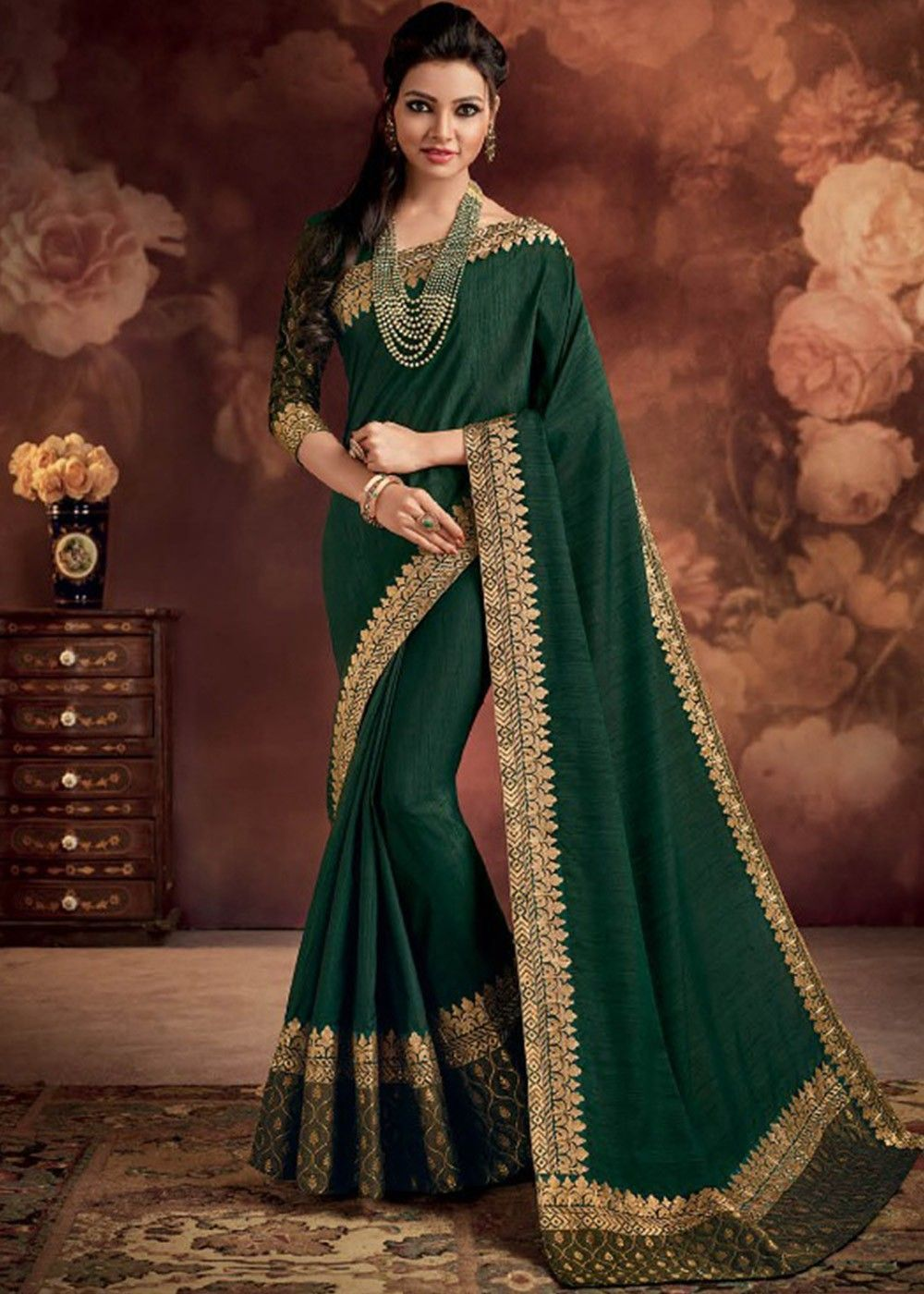 c928e08f154aa1 Dark  green  saree in art  silk enhanced by patch border and lace detail  throughout.