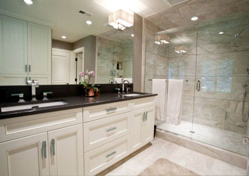 black granite top over white bathroom vanity | house to home