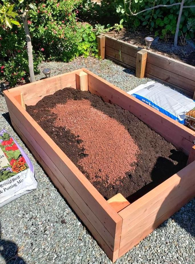 Learn tips on how to fill a new raised garden bed with the