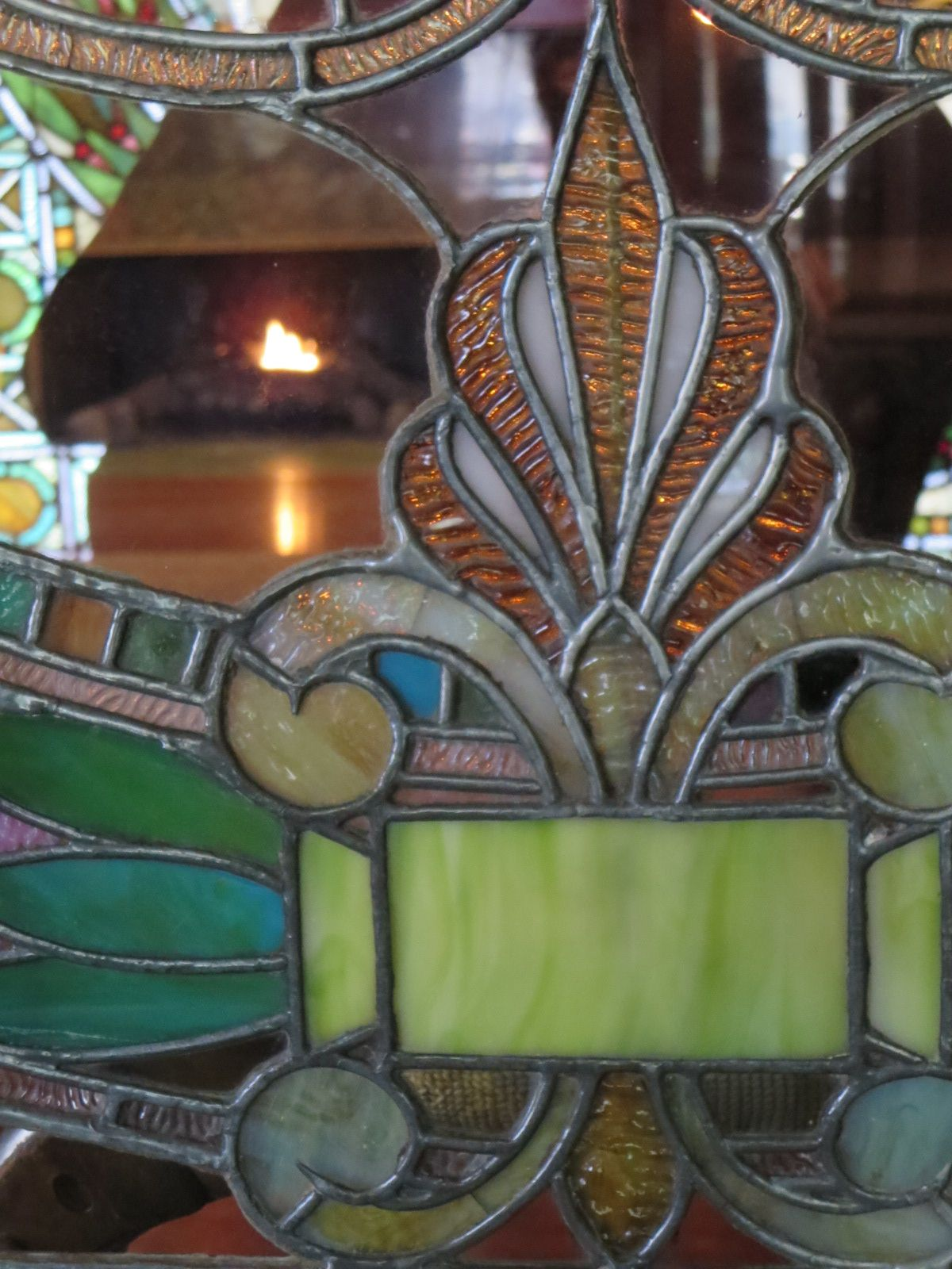 Historic Pleasant Home:  Tray and honeysuckle motifs in art glass window of Great Hall.