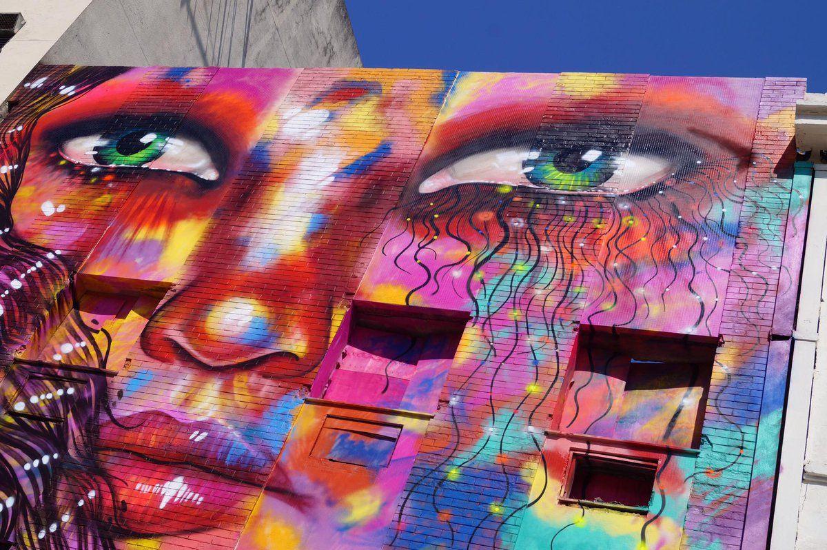 Street art by Panmela Castro in Brazil.
