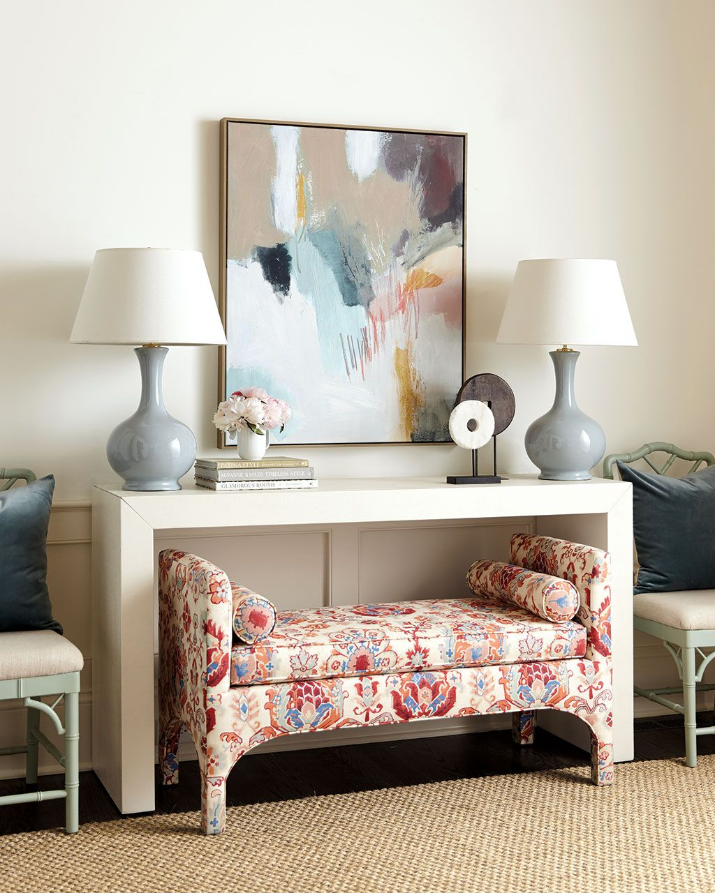 large abstract art print hung over a white console table | ballard