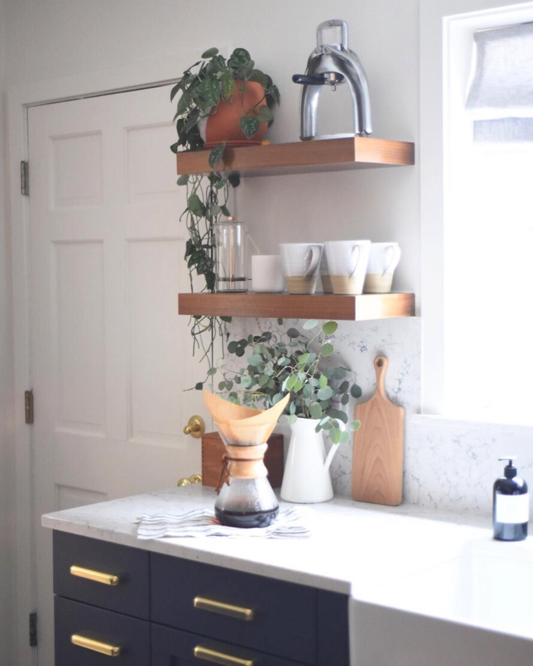 Pour Over Coffee, Navy Cabinets, Plants, And Open Shelving