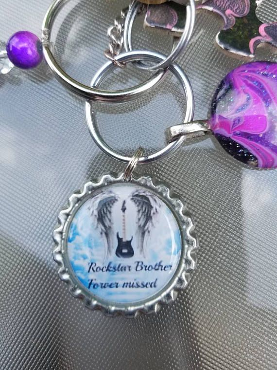 Check out this item in my Etsy shop https://www.etsy.com/listing/493743682/angel-wings-keepsake-keychain