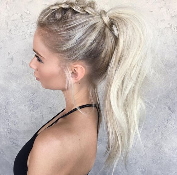 Top braid pulled back pony tail hair style