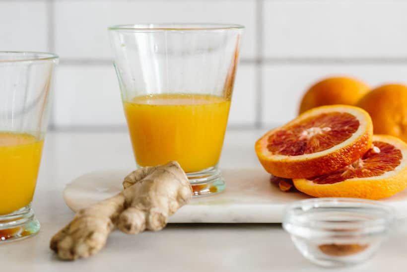Wellness Recipe Lemon Turmeric Ginger Shots The Effortless Chic Recipe Wellness Recipes Ginger Shot Turmeric Juice