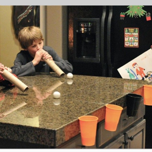 Tape plastic cups to the edge of the table. Give each player a pile of snowballs (white ping pong balls) and an empty paper towel roll. Race to see how many snowballs each player can blow across the table and into the cup. #mtarkids #mtaractivities #Padgram #holidaysinjuly