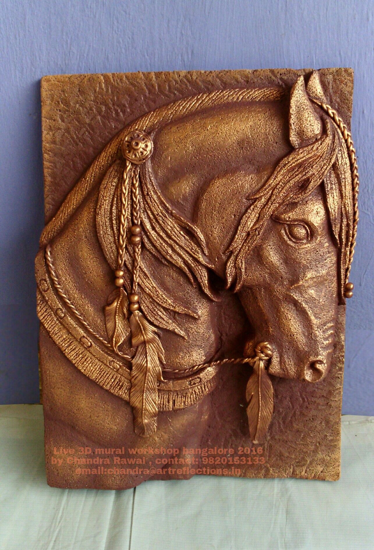 Horse hand carved relief mural on siporex block