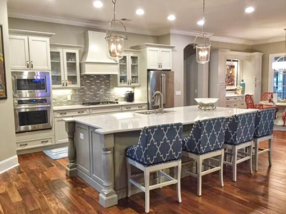 gorgeous navy and gray kitchen with white cabinets and marble island