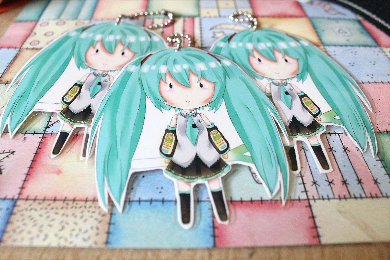 Hatsune Miku Laminated Keychains. Each come with a ball