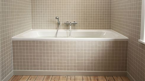 Built In Tub With Small 2 Square Tiles Molding To Blend Into
