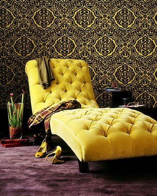 Beautiful meridian lounger, tufted yellow velvet. Such a great mix of crazy and classical. Love the wallpaper too.