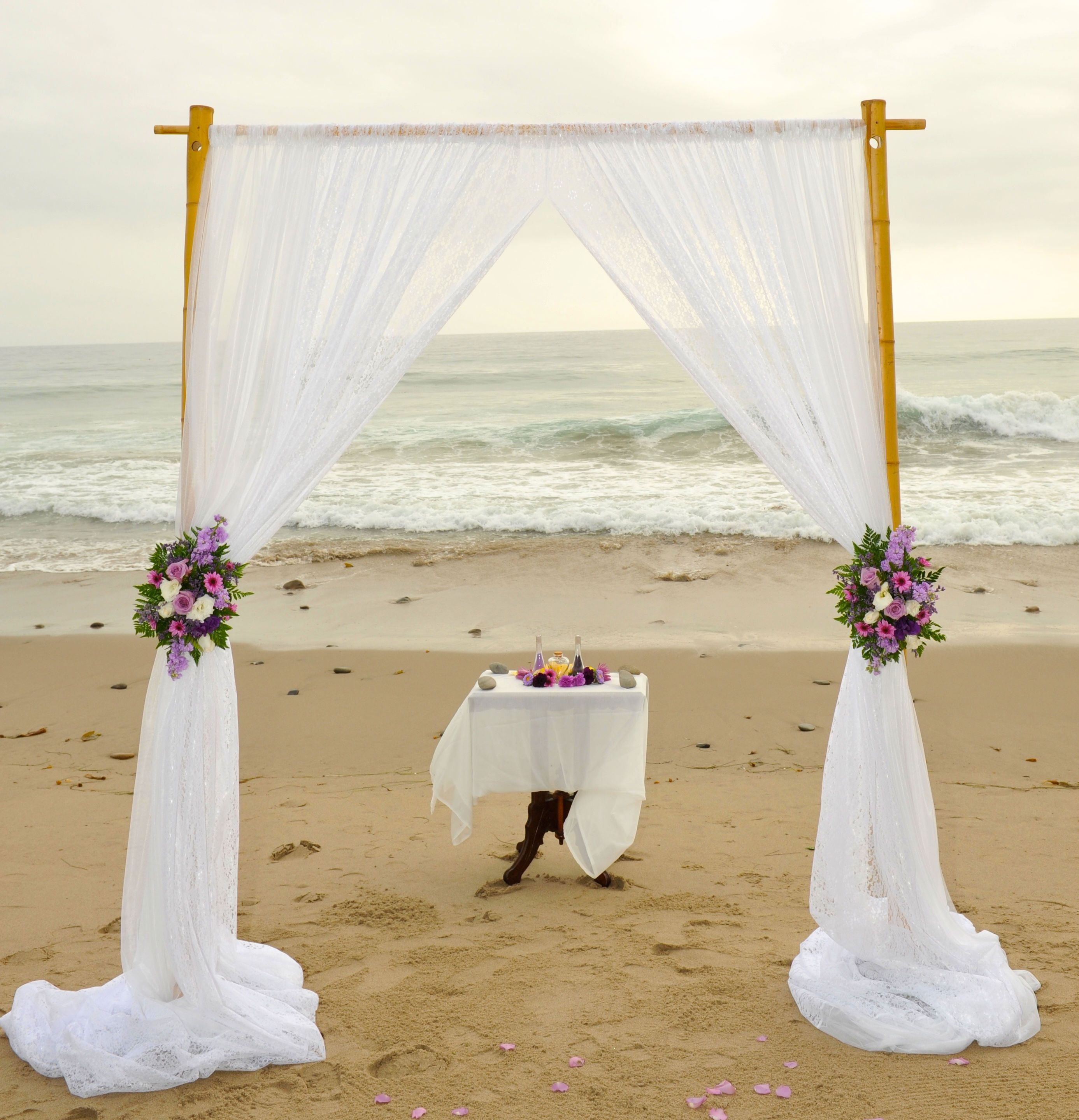 Beach Wedding Arch Decorations: Bamboo Wedding Arch, White Fabirc, Purple Flowers
