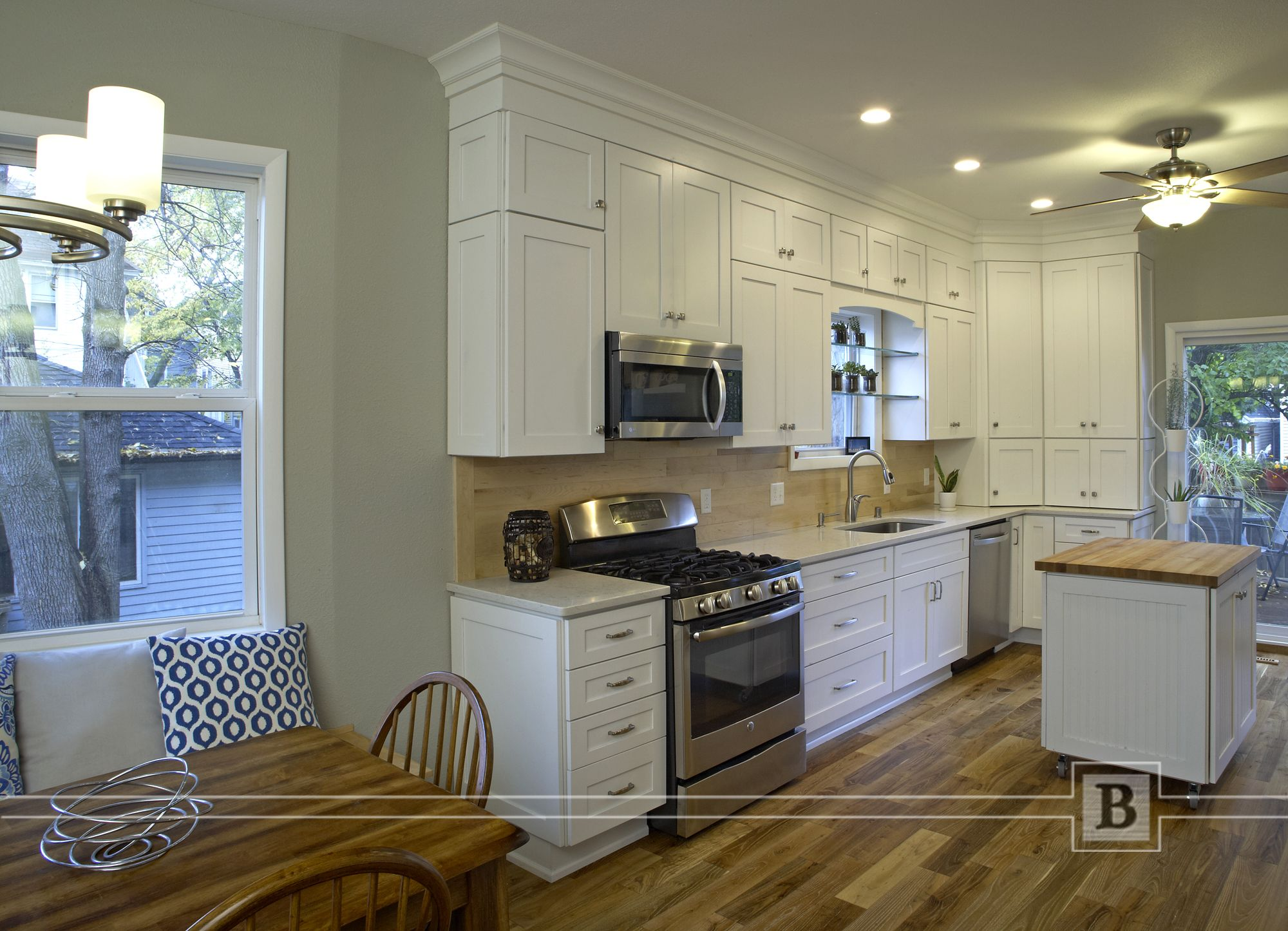 Painted White Cabinetry Stacked Wall Cabinets Wood Planked Backsplash And Quartz Tops Kitchen Design White Cabinetry Kitchen