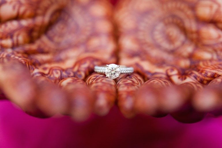 close-up wedding ring shot and bride henna