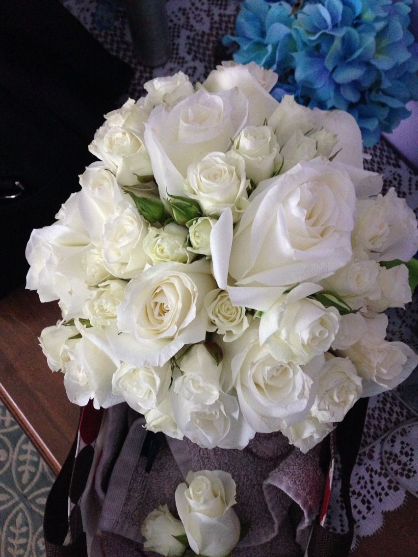 Elegant white rose bouquet by Reynolds Treasures