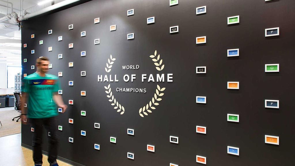 Office branding hall of fame with mini photo frames seriously cool environmental design