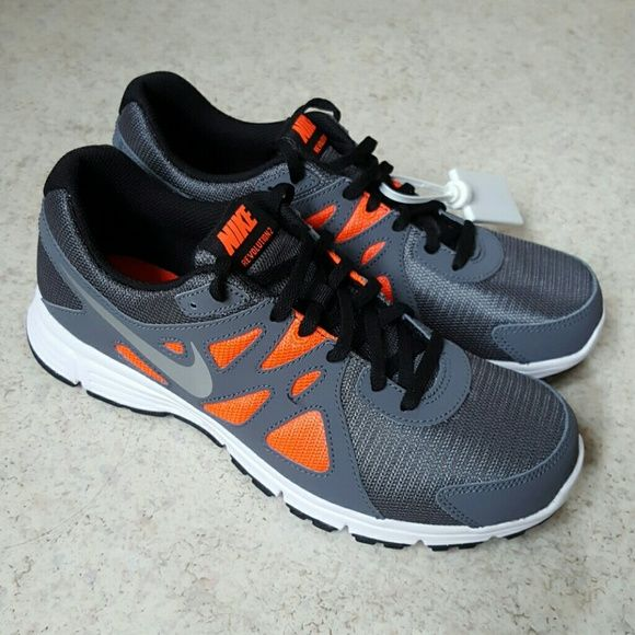 NWT NIKE REVOLUTION 2 Brand new,never worn. Women's 9 or 7Y. The bright color is between red and orange.  It looks little bit brighter in pics Nike Shoes Sneakers