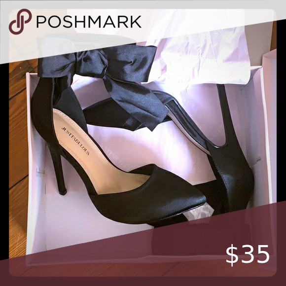 Photo of Black Pumps Wide width black pumps with bow. Size 9. Worn once for a photo shoot…