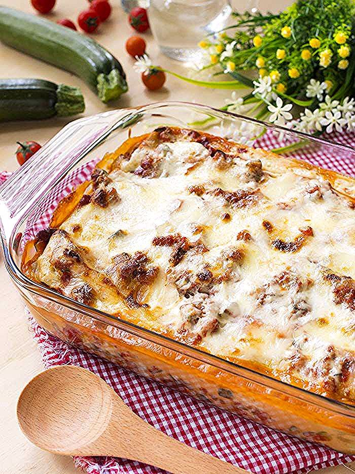 Photo of Here are the lasagna with courgette sauce served on the table! Co …