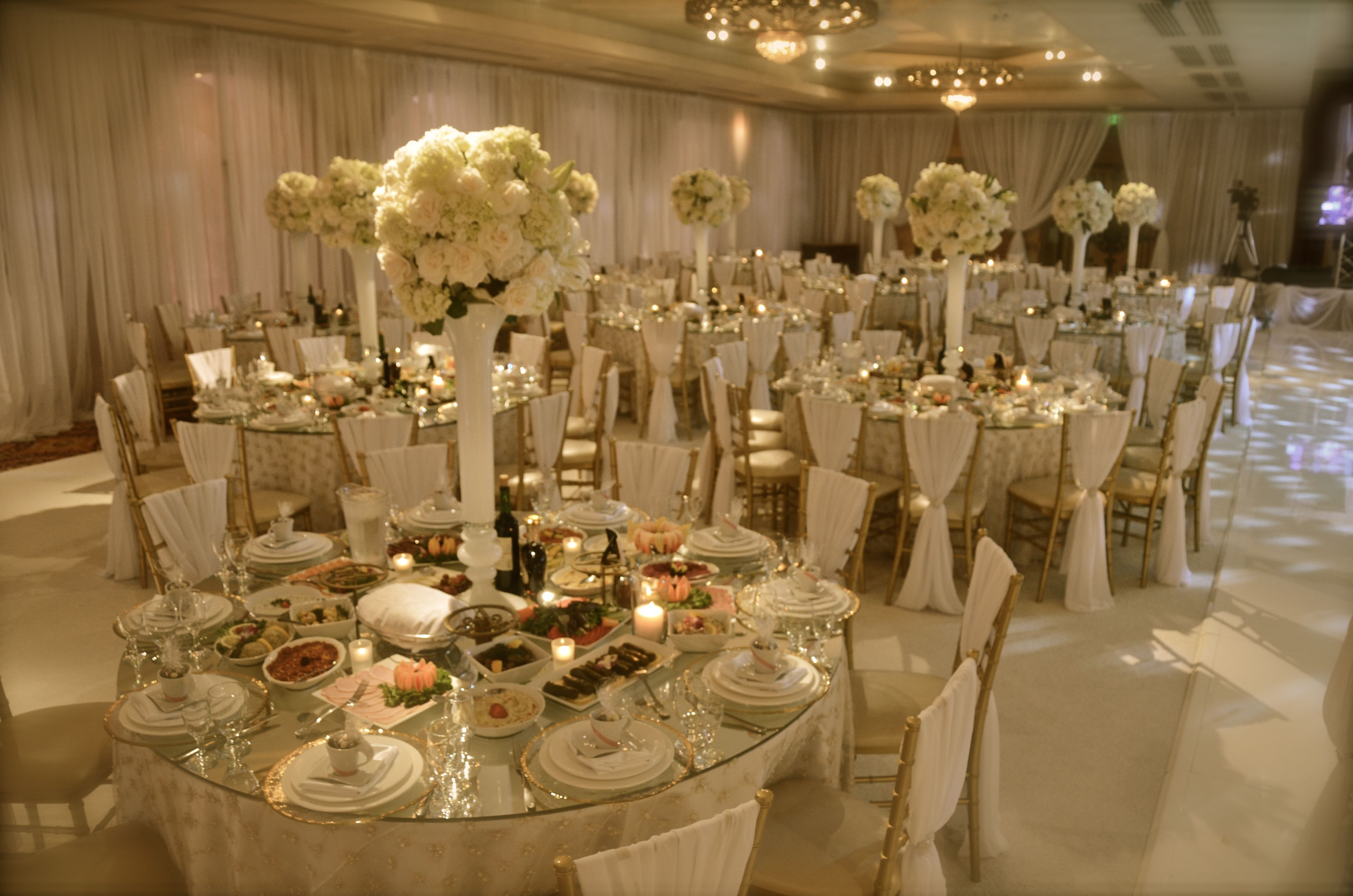 Fancy chair rentals - All White Wedding With Gold Accents Draped Chiavari Chairs Tall Elegant Floral Centerpieces