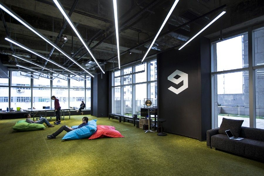Hong kong warehouse converted to creative office space for Unique office interiors