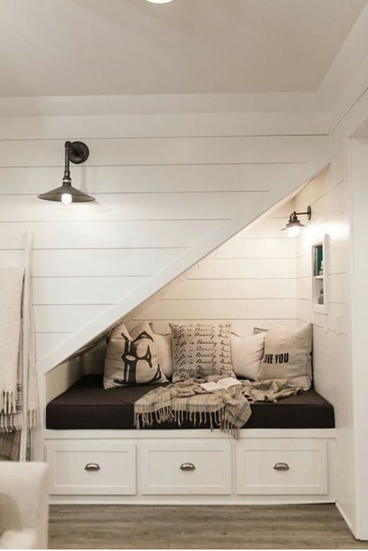 Under stairs nook with shiplap and barn doors farmhouse for Sofa bajo escalera