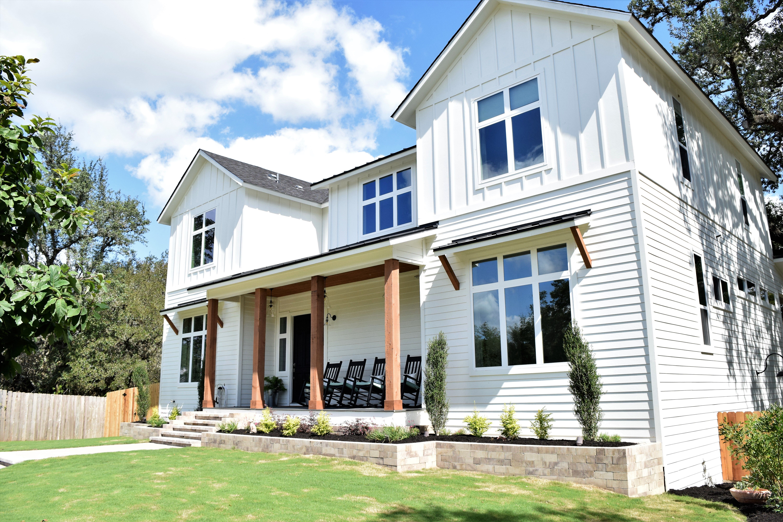 All white modern farmhouse exterior with white windows and